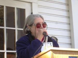 Jackie Rapport at the microphone. Jackie and President Peggy Collins were co-chairmen of the tree planting