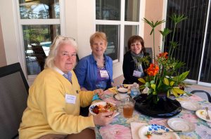 Yellow sweater is new member Denise H., Center is 1st VP Jill T. and behind plant is Recording Sec. Clare D.
