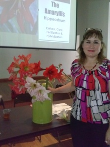 Member & April's Speaker Theresa Schretzmann-Myers with some amaryllis blooms from her garden