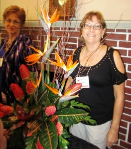 Joan Y. admiring the centerpiece created by one of our hostesses Vicki H. The beautiful floral arrangement was created almost entirely from materials from her own yard.