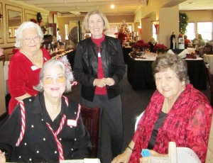 Standing in on left is Barbara B. and on right is Angela W. Sitting on left is Jackie R. and right is President Peggy C.
