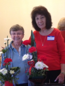 Co-chairmen Joan P. in blue and 2nd VP Maureen T. in red