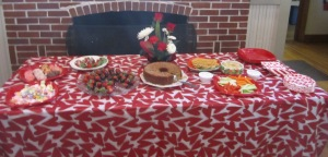 Wonderfully Valentines' themed snack table. Floral arrangement by one of our hostesses Janet S.