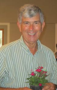 Speaker Tom MacCubbin with Dianthus plant.