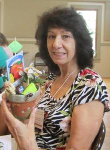 Marlene T. wins a decorative pot created by our speaker's wife Joanne MacCubbin.