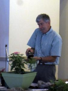 Speaker Tom MacCubbin adding dianthus to a fall planting.
