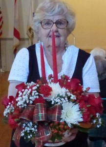 1st VP Mary B. with complete Christmas arrangement by of Betty J's Florist of Ocoee, FL. Photo by Maureen T.