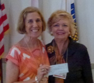 Angela W. accepts a donation from our club for Nehrling Gardens from President Bonnie B. (Photo by Maureen T.)