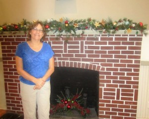 Vicki H. decorates mantel and fireplace at Windermere Town Hall.