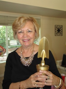"President Bonnie B. with Dist. VII's ""traveling trowel"" award"