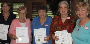 Left to right: Vicki H., 1st VP Mary B., Peggy C., Jackie R., and President Bonnie B. with the four awards that our club won at the 2016 FFGC Convention for some of our projects.