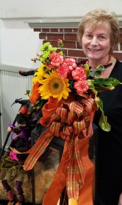 Hostess Diana L. with her arrangement